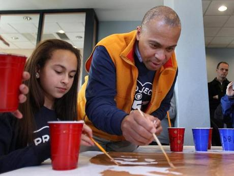 During the day of service and celebration, Governor Deval Patrick lent a hand to Madi Andrade, 13, of Falmouth.