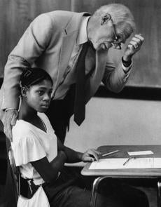 9/7/1983 Mayor Kevin White checks out assignments for Marcelle Thompson, Grade 6.