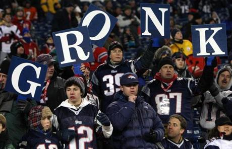 Patriots fans held signs spelling