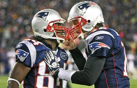 slider -- 1-14-12: Foxborough, MA: Patriots quarterback Tom Brady (right) celebrates with wide reciever Deion Branch after Branch's second quarter tocuhdown pass reception. The New England Patriots hosted the Denver Broncos in an NFL AFC Divisional Playoff game at Gillette Stadium. (Globe Staff Photo/Jim Davis) section:sports topic:Patriots-Broncos