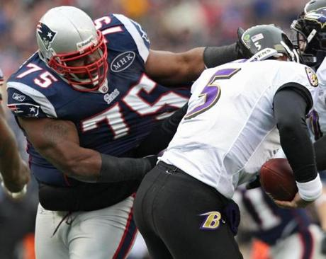 1/22/12 Foxborough, MA New England Patriots Vince Wilfork sacks Baltimore Ravens quarterback Joe Flaco during 1st quarter action in the AFC Championship Game at Gillette Stadium on Sunday January 22, 2011. (Matthew J. Lee/Globe staff) slug: 23patriots section: sports Reporter: