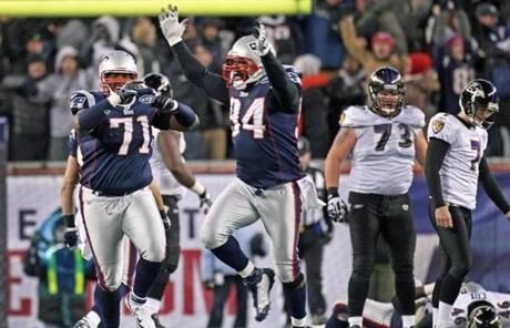 slider -- 1-22-12: Foxborough, MA: The Patriots Brandon Deaderick (71) and Shaun Ellis (94) celebrate after Ravens kicker Billy Cundiff (7,far right) missed the potential game tying field goal. The New England Patriots hosted the Baltimore Ravens in the AFC Championship Game at Gillette Stadium. (Globe Staff Photo/Jim Davis) section:sports topic:Patriots-Ravens