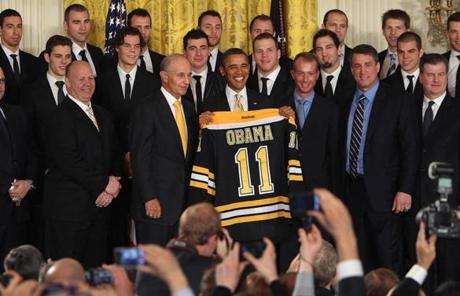 The Bruins presented Obama with a team jersey bearing his name.