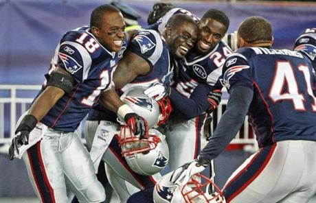 1-22-12: Foxborough, MA: Patriots Matthew Slater (18) James Ihedigbo, Kyle Arrington and Malcolm Williams celebrate after the Ravens kicker Billy Cundiff (not pictured) missed the potential game tyying field goal. The New England Patriots hosted the Baltimore Ravens in the AFC Championship Game at Gillette Stadium. (Globe Staff Photo/Jim Davis) section:sports topic:Patriots-Ravens