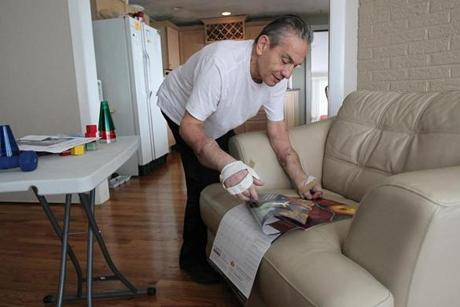 Revere, MA., 01/26/12, Richard Mangino, cq, lost his arms and legs ten years ago. Four months ago he got a double hand-transplant. We visit him at his home to see his progress. This calander includes some of his artwork, which he has not begun to do again. Section: Health Science, Reporter: Liz Kowalski Suzanne Kreiter/Globe staff