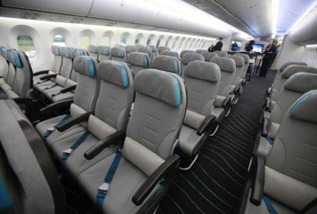 A picture shows the economy seating of the new Boeing 787 Dreamliner passenger jet at the Dublin International airport in Dublin, Ireland on January 26, 2012. As part of the Boeing 787 Dream Tour, Boeing brought the 787 Dreamliner to Dublin Airport to give key aviation finance leaders attending the 14th Annual European Airfinance Conference in Dublin the opportunity to see the airplane first hand. AFP PHOTO / PETER MUHLY (Photo credit should read PETER MUHLY/AFP/Getty Images)