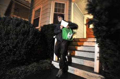 Ed Loechler leaves a house after dropping off brochures as he walks through his neighborhood in Brookline with literature explaining renewable energy programs abailable from utilitiy companies. Despite publicity, utility companies have seen little participation in their renewable energy programs. JOSH REYNOLDS FOR THE BOSTON GLOBE (Science, Able)
