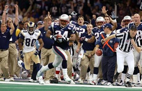 Ty Law's 47-yard interception return for a touchdown in the second quarter helped the Patriots build a 17-3 halftime lead.