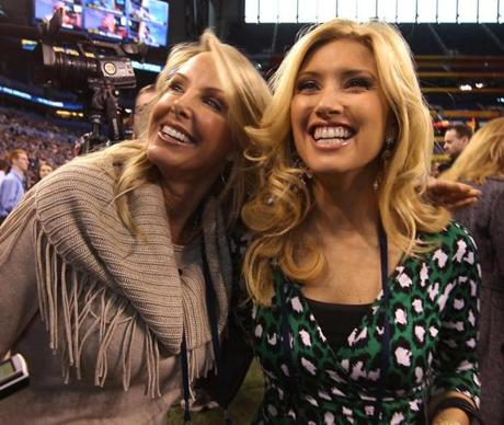 Indianapolis, IN [Lucas Oil Stadium/Superbowl media day]--Jan 31, 2012--(left to right), Linda Holliday (cq) girlfriend of Patriots head coach Bill Belichick and NewsCenter 5 tv anchor Bianca de la Garza (cq) at Superbowl media day. Globe Staff Photo/Jim Wilson