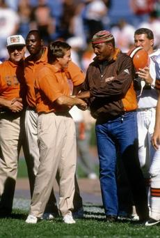 CIRCA 1994: Head coach Bill Belichick (L) of the Cleveland Browns tallks with Cleveland Browns running back great Jim Brown (R) on the sidelines circa 1994 before an NFL football game. Belichick was the head coach of the Browns from 1991-95. (Focus on Sport/Getty Images)