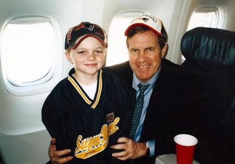 credit: June Ingraham -- Bill Belichick and his Wesleyan friend's (Rob Ingraha) 8-year-old son Tucker Ingraham celebrating the Super Bowl victory in Houston ( 2004 ) on the team charter flight back to Boston. The photo was taken by June Ingraham