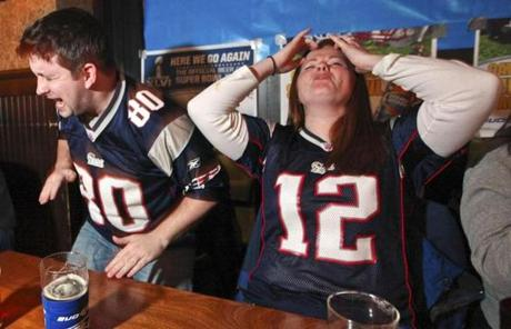 Liam Curran, 31, of Dorchester, and Anna McDonough, 30, of Melrose, reacted while watching the game at Clery's in Boston.