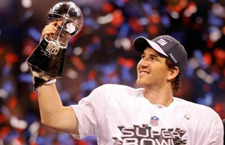 Quarterback Eli Manning posed with the Vince Lombardi Trophy. Manning was also named the game's MVP.