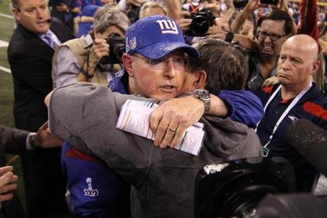 Coughlin embraced Patriots coach Bill Belichick after the game.