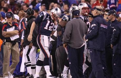 Tom Brady walked off the field after getting sacked in the third quarter.