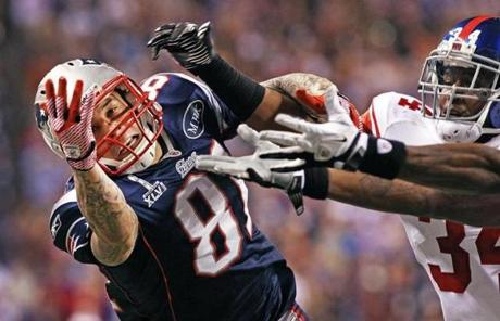Patriots tight end Aaron Hernandez couldn't quite reach a pass from Tom Brady on a play late in the game.