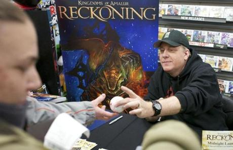 BELLINGHAM, MASSACHUSETTS -- 02/06/2012 -- Curt Schilling meets with fans at Game Stop during the release of his newest video game Kingdoms of Amalur: Reckoning late on Monday evening in Bellingham. Brian Feulner for the Boston Globe