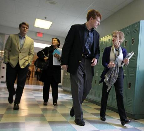 Martina Jackson, cochairwoman of the Newton Democratic City Committee, showed Joseph P. Kennedy III around Newton South High School where the candidate attended a Democratic caucus and met residents a fewdays before announcing his candidacy.