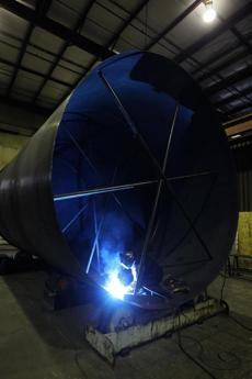A Mass Tank employee welded a tank in Middleborough. Mass Tank is building a wind turbine tower that will be trucked 20 miles to Plymouth in three parts, then assembled there.