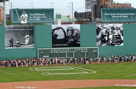 Photos of Ted Williams adorned the left field wall, behind the area he used to patrol for the Red Sox.
