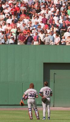 Roger Clemens and Toronto catcher Charlie O'Brien stood for the singing of the Canadian national anthem before his first game back at Fenway Park.