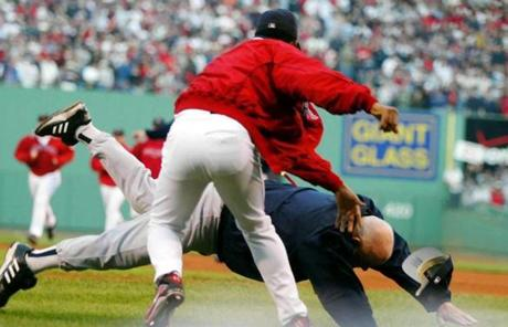 Yankees bench coach Don Zimmer was thrown to the ground by Martinez during fourth-inning altercation.