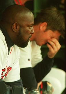 Mo Vaughn, left, and Scott Hatteburg their showed frustration in the dugout.