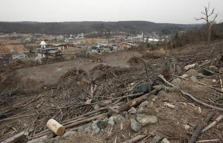 The view toward Monson from Ely Road shows the destruction that still exists eight months later.