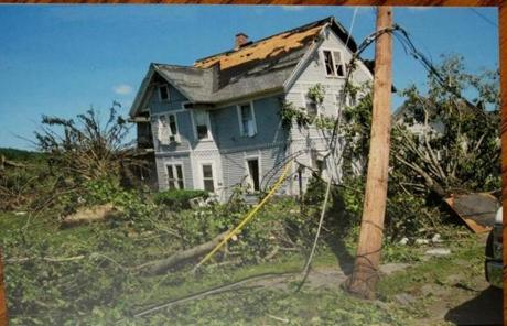 A closer look at a photo of  Slozak's home after it was destroyed by the tornado in 2011.