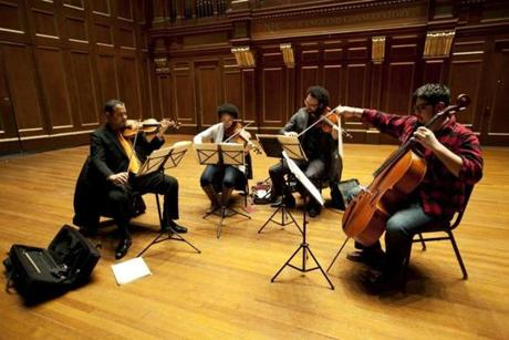The Harlem Quartet, from left, violinist Ilmar Gavilan, violinist Melissa White, violist Juan Miguel Hernandez, and cellist Paul Wiancko practiced before their performance at Jordan Hall in Boston on  Feb. 16, 2012. Paul Wiancko announced to the group last fall that he would be leaving.