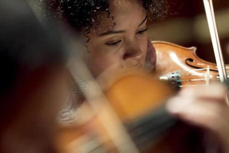 Melissa White practiced before The Harlem Quartet's performance in Boston.
