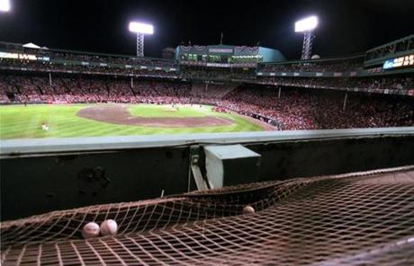Balls sat in the net atop the Green Monster after being blasted during the home run derby.
