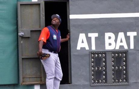 Padres outfielder Tony Gwynn took a peek inside the Green Monster during practice earlier in the day.