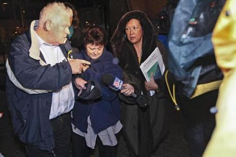 12/07/2011 BOSTON, MA Linda Duffy (cq) (2nd from left) leaves The John Joseph Moakley United States Courthouse (cq) following her arraignment . Linda Duffy, a former Saugus Public Library employee, has been indicted by a federal grand jury on charges of stealing $800,000 from the Library. The man with her is believed to be her husband but could not be confirmed. (Aram Boghosian for The Boston Globe)