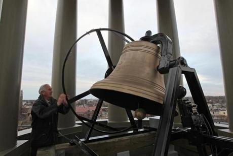 Quincy, MA - 02/21/12 - A new bell was installed as part of the United First Parish Church in Quincy Bell Tower renovation. Here James P. Edwards, cq, Quincy Architect and Project Manager City of Quincy, rings the bell. - (Globe Staff Photo / Barry Chin), section: South Week, reporter: bartlettj, slug: 26sotower, LOID: 5.0.860875697.