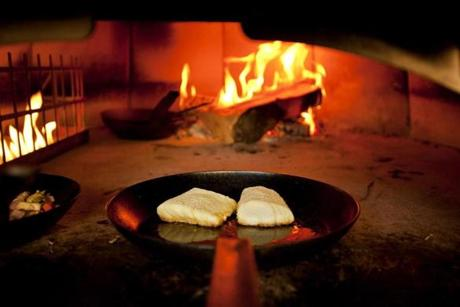 The topic of seafood sustainability has been under discussion so long it's gone from buzzword to cliché. Here, cod was cooked in a wood-burning oven at Area Four in Kendall Square.