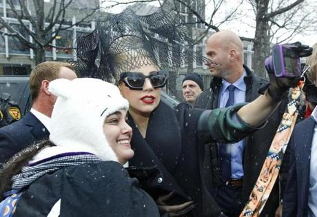 During her visit, she braved light snow, met some fans, and stopped for pictures.