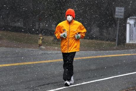 "Jogger John Canty, 68, of Webster. Said Canty: ""These snowflakes invigorate me. Makes me feel like a new man. It reminds me how lucky I've been this year not having major snowstorms. This is just a reminder of what could have been. ... I run for the cardio, to keep my weight down and because it makes me feel stronger. I've done 10 Boston Marathons. This is just a fabulous year for an athlete. I think this will be a record breaking year at the Boston Marathon as far as times go because you're able to train constantly through the winter as compared to years past where we weren't able to run because of the snow and ice. ... In my young tender I don't remember anything like this. This is the best winter ever. I'm up at 4 in the morning and I do two miles then. Then I come back and do the rest in the afternoon. It just makes me feel a lot better. A few years ago I was attacked by a couple of German Sheperd's on this road, right over there as a matter of fact, but I got away."""