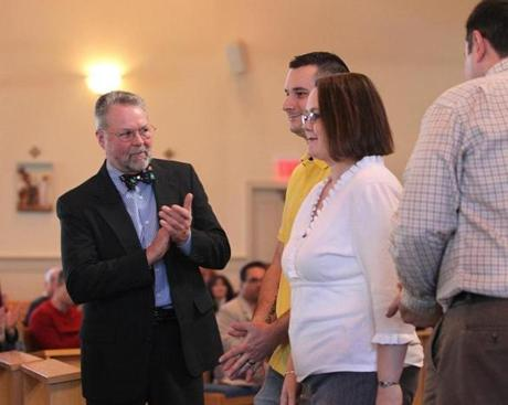 Sponsors Dana Shaw (left) and Scott Strothers (right) led the acknowledgment for Michael Mayott and Shelley Rinehart, candidates to become Roman Catholics, after a formal announcement was made that they are committed to the faith. The two are enrolled in Rites of Christian Initiation for Adults class.