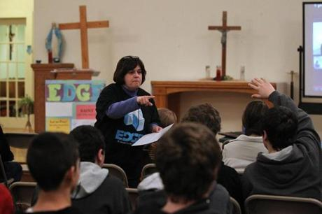 Director Robin Muise quizzed students in the religious education class for eighth-graders in the old mission church at St. Joseph the Worker.