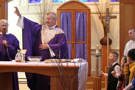 The Rev. John Mark Hannon and Deacon Jack Alexander (left) celebrated Mass.