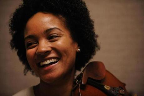 Melissa White laughed during the audition of a new member, a cellist, on March 1, 2012.