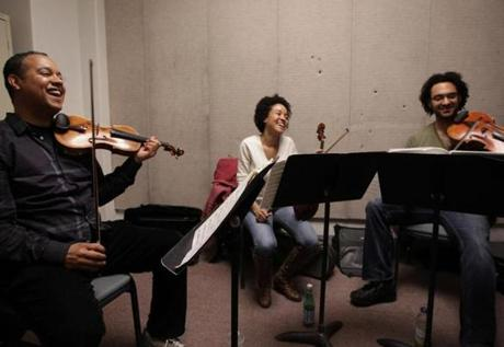 Gavilán, White, and Hernandez shared a light moment while they auditioned a potential new cellist (not shown) on March 1, 2012, at the New England Conservatory.