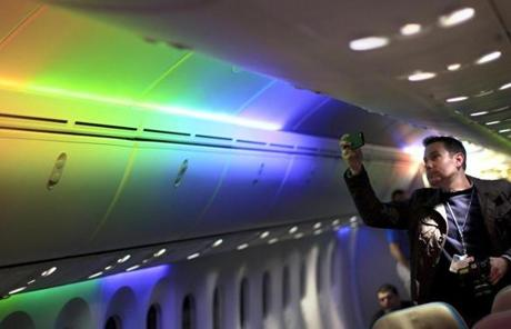 LED lights run down the length of the plane on the ceiling.