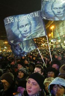 Supporters of Vladimir Putin rallied near the Kremlin in Moscow on Sunday as he won the race for president.