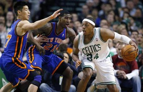 Pierce controlled the ball as Lin and Shumpert defended in the third quarter.