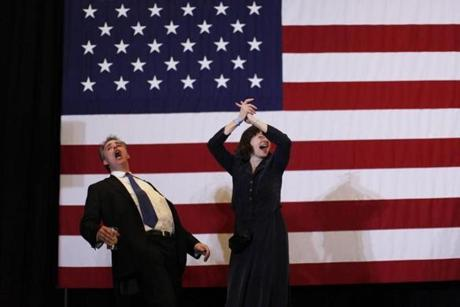 Chris and Ellen Finlay of Uxbridge danced on a stage in front of an American flag as the band played