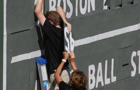 Unlike the original, however, workers must adjust the scoreboard from the exterior using a ladder during stops in play.