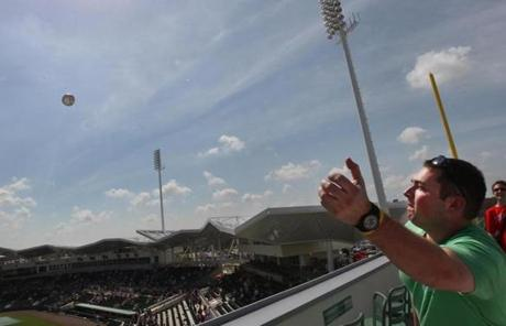 On top of the wall, fans are able to catch home runs hit during games and batting practice sessions.