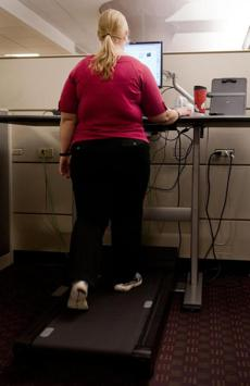 Elyse Blanda, a contract specialist at the Blue Cross Boston office, has decided to use a treadmill desk at work.